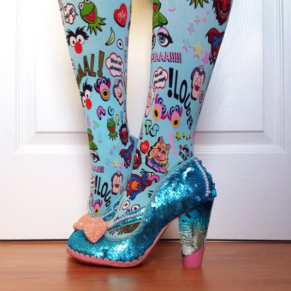legs wearing turquoise Muppets print tights with blue sequins shoes with perspex heel
