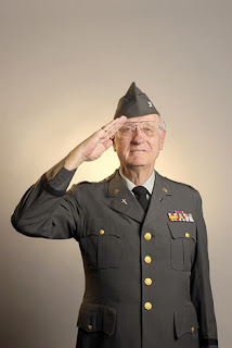 Photo of a senior United States veteran saluting