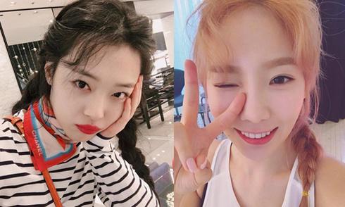 Sao Hàn 10/3: Sulli xinh đẹp hơn sau chia tay, Tae Yeon nháy mắt xì tin