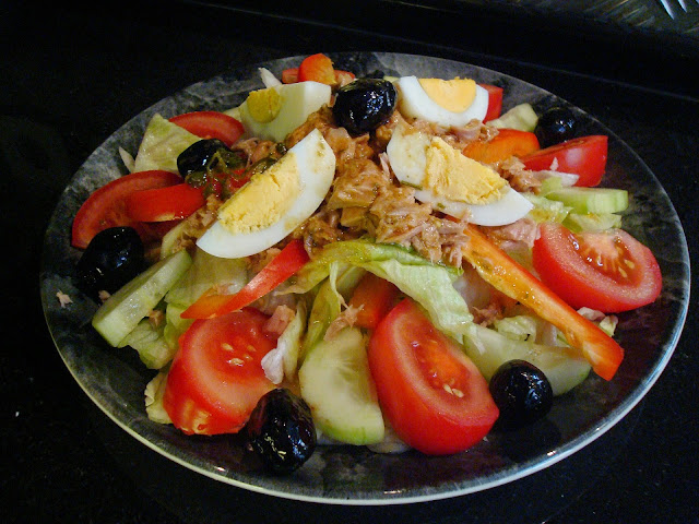Salad with tuna, tomatoes, olives, and hard-boiled eggs