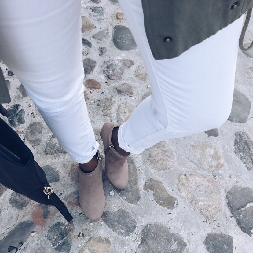 Pair your taupe booties with some white skinny jeans and a neutral top and jacket.