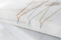 Aquamarine pendants in 14k yellow white rose gold