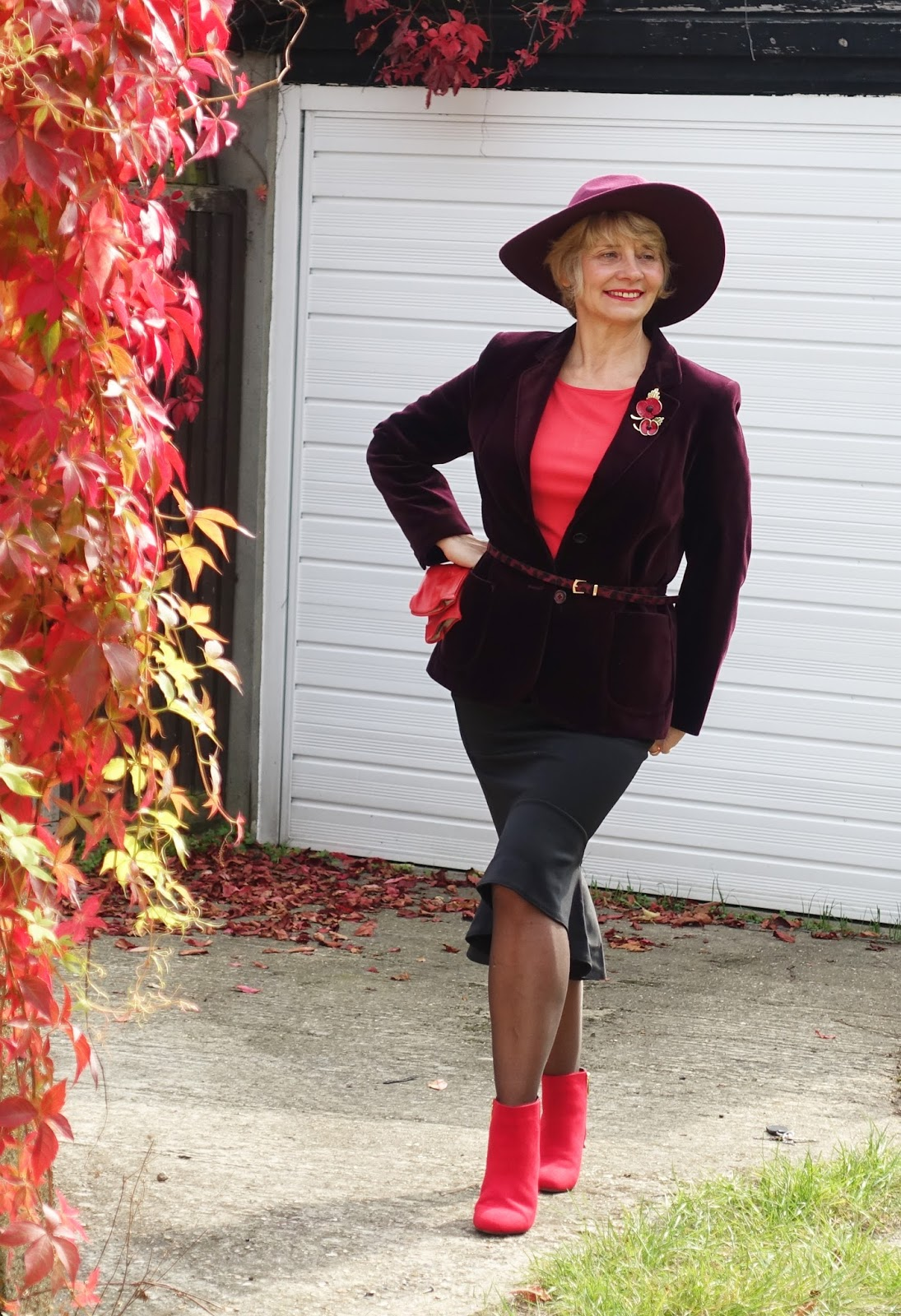 Gail Hanlon in burgundy fedora hat and mixing red with burgundy