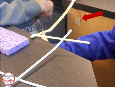 STEM Challenge: The bridge made of straws needed to support the weight of a tower that would be placed on the bridge later. This group used craft sticks to connect the straws across the opening for the bridge, but the straws and sticks kept slipping. They added a rubber band and then taped it in place to stop the movement of their bridge.