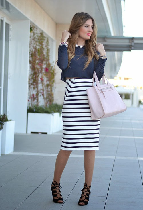 She is wearing a white stripe midi skirt