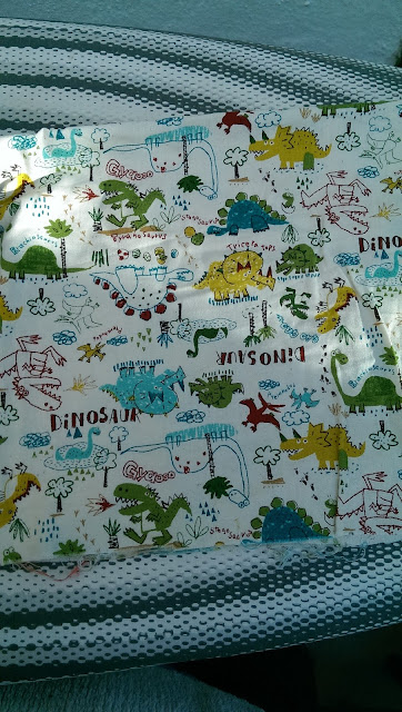 Quilting cotton featuring cartoon dinosaurs