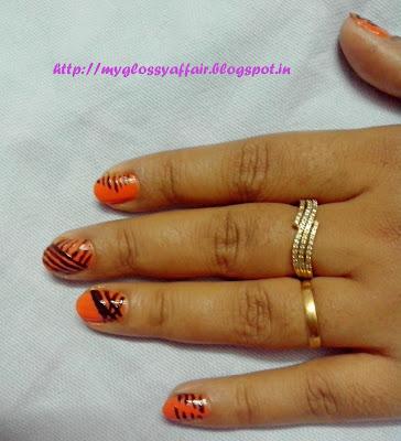 Orange Black Striped Nail Art