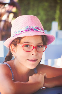 Image of a young girl wearing glasses
