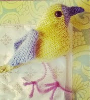 http://www.ravelry.com/patterns/library/feathered-friend