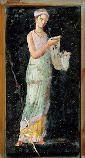 Woman reading a scroll (fresco from Pompeii)