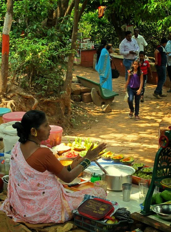 Woman vendor selling drinks and snacks