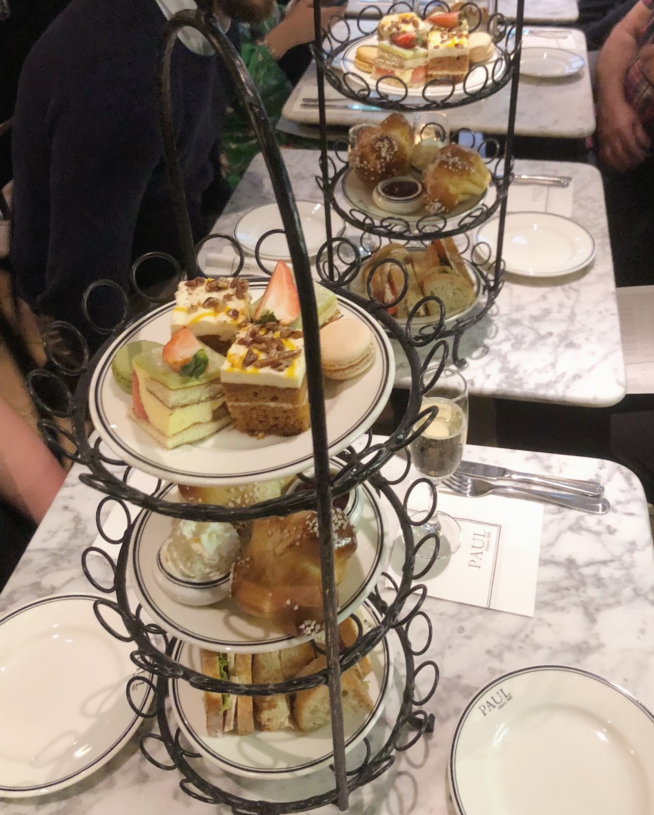 Afternoon tea with three-tiered with cakes and scones