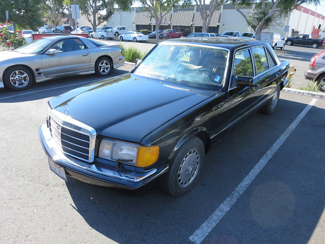 Mercedes 300SD in new, gloss black paint.