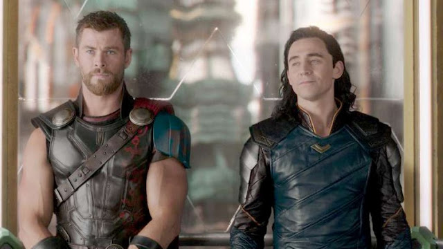 "Chris Hemsworth and Tom Hiddleston smirk and squabble in ""Thor: Ragnarok"""