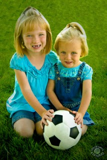 Professional quality portrait photograph of two young girls and sisters with a soccer ball in Pocatello, Bannock, Idaho by Cramer Imaging