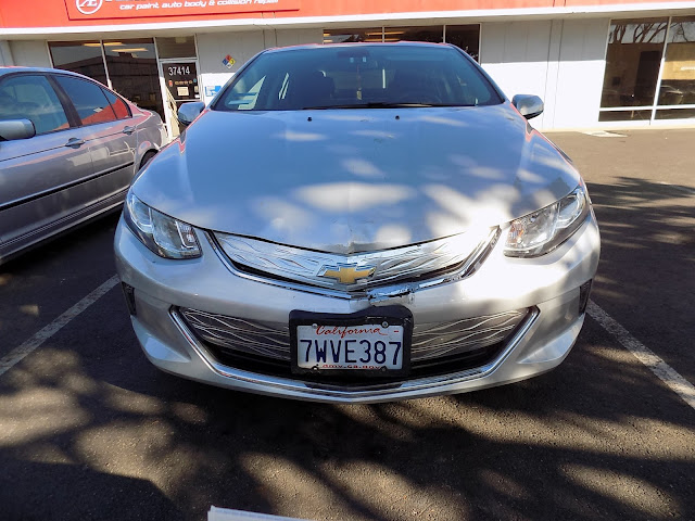 Damaged hood & bumper on 2017 Chevy Volt before collision repairs at Almost Everything Auto Body.