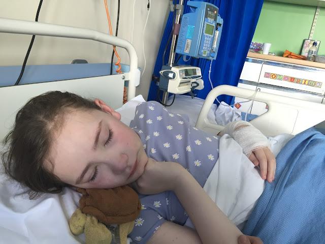 Sasha in hospital bed
