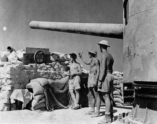 British at Tobruk under a captured Italian 149 mm gun, 1 September 1941 worldwartwo.filminspector.com