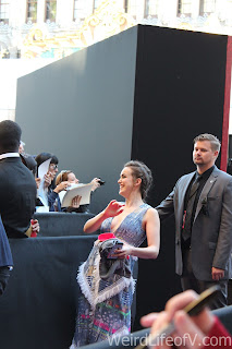 Elizabeth Henstridge posing for a fan's camera