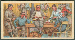 A card bearing an illustration of a group of men smoking, drinking, and playing music together.