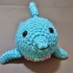 http://www.craftsy.com/pattern/crocheting/toy/little-chubby-dolphin/98429