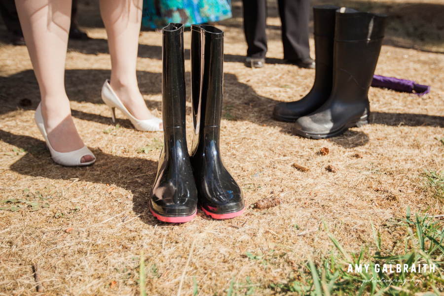 bride standing next to pink and black rain boots