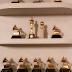 Proud wifey! Chrissy Teigen shows off John Legend's awards shelf