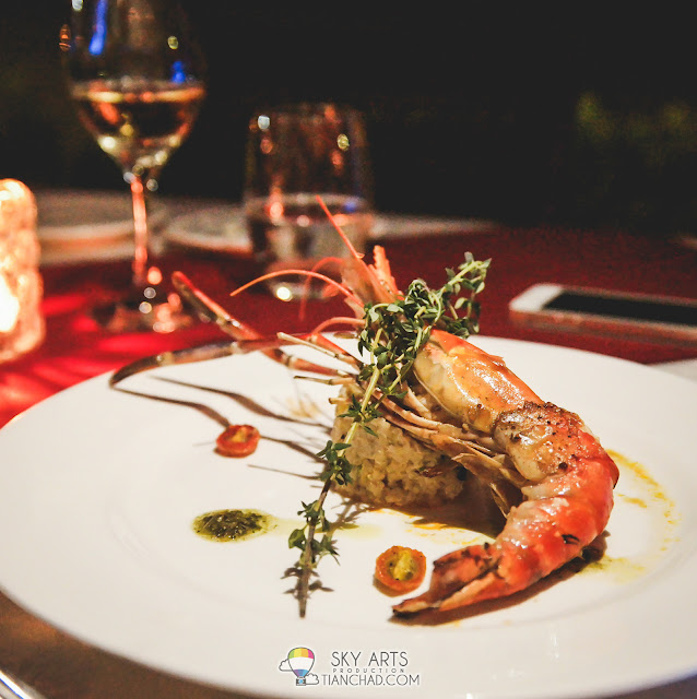 Grilled prawn with quinoa risotto served with fresh basil pesto sauces