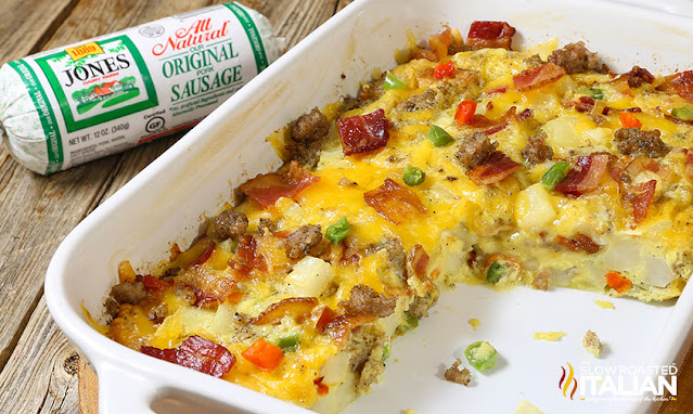 breakfast casserole with bacon, sausage, and cheese in white baking dish