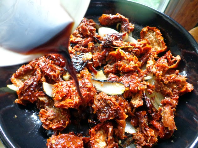 add chopped sun dried tomatoes to the pan