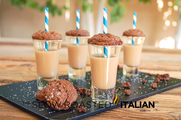 4 caramel cookie cocktail shooters with blue striped straws on serving tray