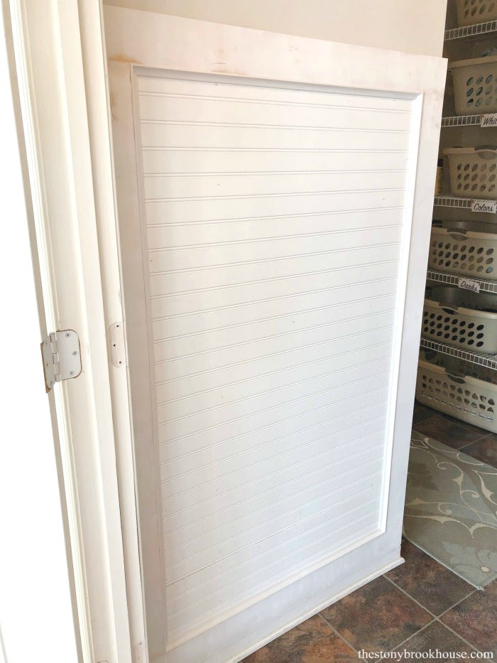 Beadboard on mudroom wall with cove trim