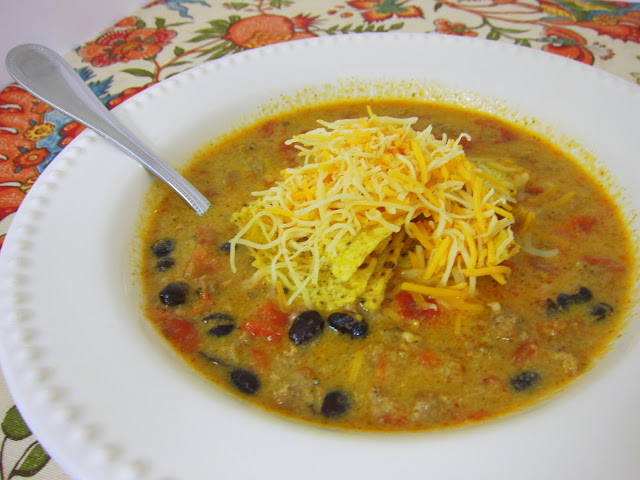 Cheesy Taco Soup - Ready in 30 minutes! Sausage/Hamburger, onion, garlic, chili powder, cumin, chicken broth, black beans, Rotel, Rotel, milk - It is hard to beat this quick soup! Reduce the calories/fat by using ground turkey. We eat this at least once a month!