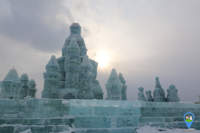 It is getting freezing and colder as the sun is disappering and heading to the night at Harbin Ice Sculpture Exhibition in Heilongjiang, China