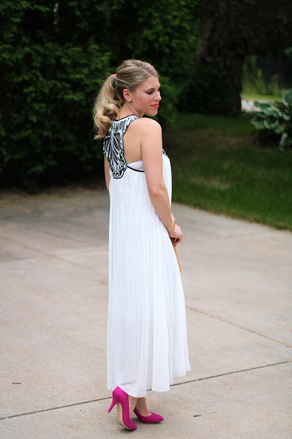 white and black embroidered maxi dress with pink heels