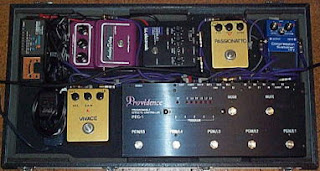 5 stomp boxes, tuner and switching unit.