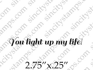 http://sincitystamps.com/you-light-up-my-life-phrase-rubber-stamp/