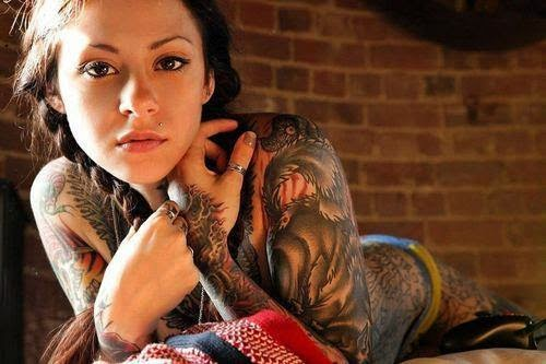 strange tattoo on a woman's body sexy
