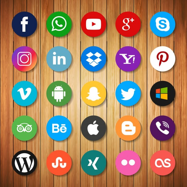 Social networking icons on wood Free Vector
