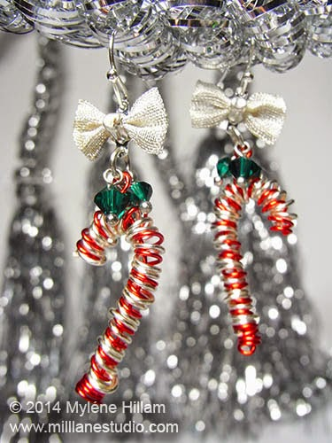 Red and silver wire candy cane Christmas earrings made by wrapping wire around a skewer.