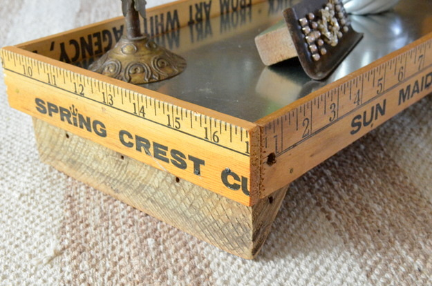 use vintage yardsticks to make a rustic tray