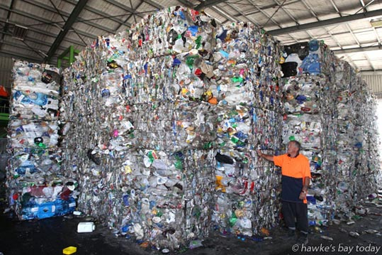 Tony Bean, supervisor, Green Sky Waste Solutions, Whakatu, near Hastings, with stacks of plastic to be recycled.  photograph
