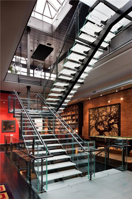 Photo of large glass staircase in the Tribeca triplex