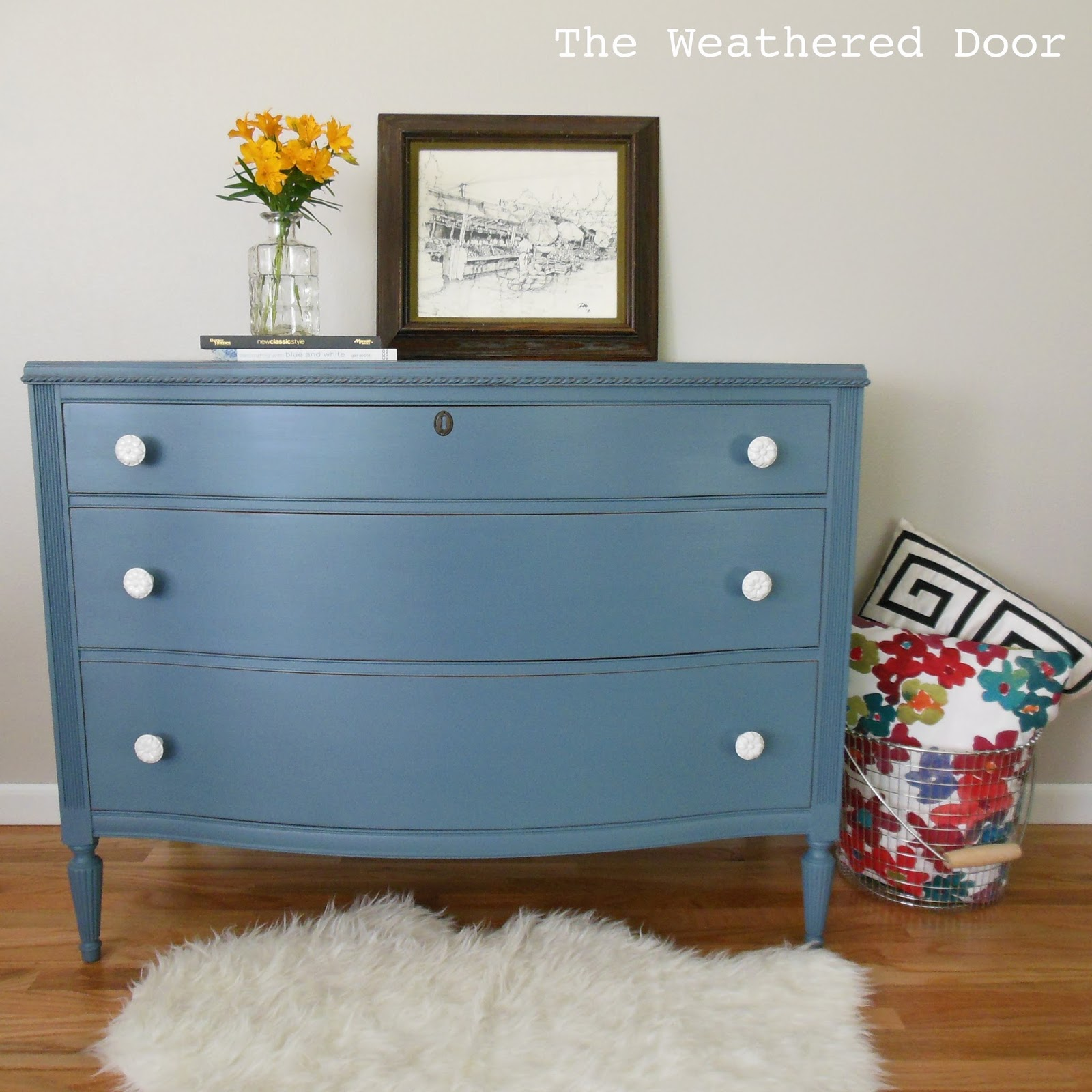 A smokey blue dresser with white knobs - The Weathered Door