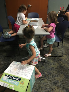 children coloring at 7th Gen Healthy Baby Home Party