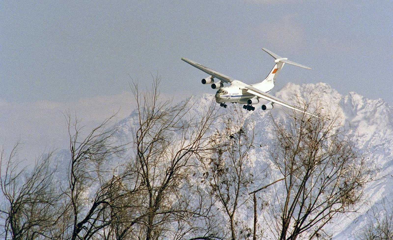 Wheels down, a Soviet transport aircraft seems to brush the treetops as it comes in to land at Kabul Airport on February 8, 1989. Soviet pilots flying in out of Kabul took defensive measures, including the firing of flares to divert heat-seeking missiles.
