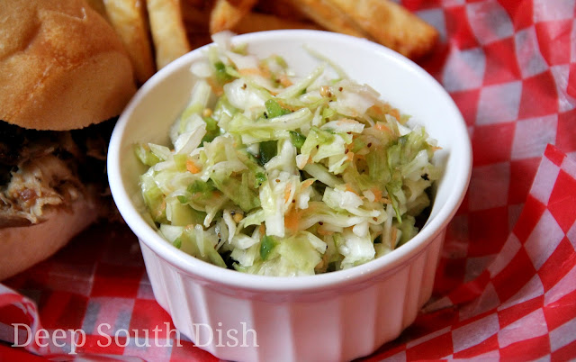 A basic vinegar coleslaw made with the addition of sweet apples and a touch of jalapeno for heat.