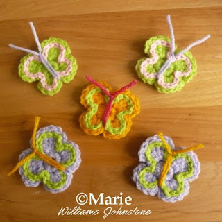 Tiny butterfly motifs which have been crocheted