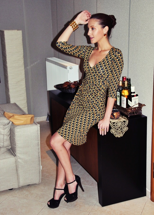printed wrap dress black high platform heels crystal jewelry