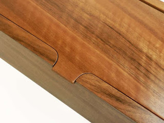 Detail of a wooden box lid in French walnut